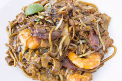 Singapore Char Kway Teow Closeup. Singapore Char Kway Teow Rice Noodle Stir Fry with Prawns Chinese Sausage and Fishcake Closeup royalty free stock photo