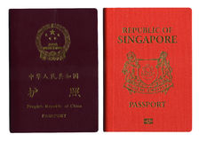 Singapore & China Passport. China & Singapore Passports isolated in white background Stock Photos