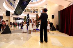 Singapore Choir Perform Christmas Carols. A group of young children performing Christmas Carols at ION shopping mall stock images