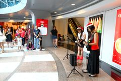 Singapore Choir Perform Christmas Carols. A small group of performer performing Christmas Carols at a shopping mall stock image