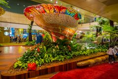 SINGAPORE - CIRCA AUGUST, 2016: Indoor view of people walking in a small garden with plants inside of Singapore Changi. Airport. Singapore Changi Airport is the Royalty Free Stock Photos