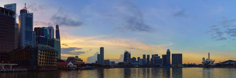 Landscape of Marina Bay and the city center of Singapore at sunset time. Stock Image