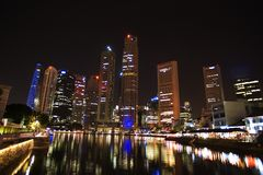 Singapore - city center, night view. Skyscrapers above the river Stock Image