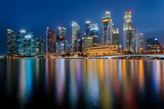 Singapore city downtown reflecting in water at Marina Bay Royalty Free Stock Images