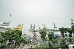 SINGAPORE CITY, SINGAPORE. February 2, 2018: View of container terminal at the Port of Singapore. Cargo ships docked in harbor Stock Photo
