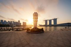 Singapore City - July 29, 2018 : Back of Merlion and Marina Bay. Sands at sunrise with Singapore Flyer and twilight sky Royalty Free Stock Image