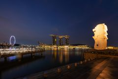 Singapore City - July 29, 2018 : Merlion and Marina Bay Sands at. Night with Singapore Flyer Stock Photos