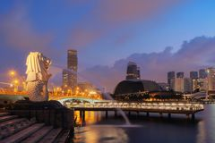 Singapore City - July 29, 2018 : Merlion and skyscrapers building. S at sunrise and twilight sky Royalty Free Stock Photos