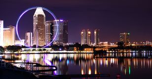 Singapore city lights and ferris wheel stock photos