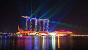 Singapore city at night with laser show Royalty Free Stock Photography
