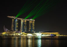 Singapore city at night with laser show Royalty Free Stock Images