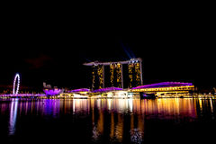 Singapore city at night with laser show Stock Photography