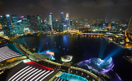 Singapore city at night with laser show Stock Photo