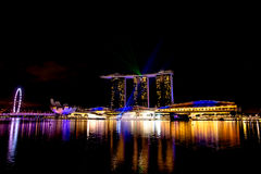 Singapore city at night with laser show royalty free stock image