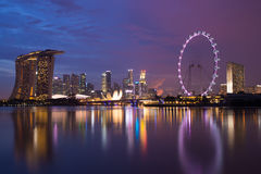 Singapore city. A photo of singapore skyline in a twilight blue sky with the singapore flyer Royalty Free Stock Image