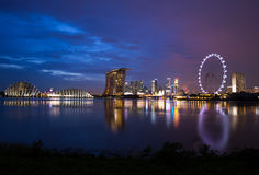 Singapore city. A photo of singapore skyline in a twilight blue sky with the singapore flyer Royalty Free Stock Photography