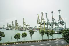 SINGAPORE CITY, SINGAPORE. February 2, 2018: View of container terminal at the Port of Singapore. Cargo ships docked in harbor Royalty Free Stock Photo