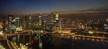 Singapore City Skyline at Dusk Panorama. Singapore City Skyline by River at Dusk Aerial View Panorama Royalty Free Stock Images