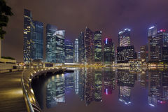 Singapore City Skyline Marina Bay Boardwalk Night. Singapore Central Business District City Skyline Along Marina Bay Boardwalk at Night royalty free stock image