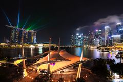 Singapore city skyline at night with laser show. Stock Image