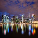 Singapore city skyline at night. With reflection Stock Photos