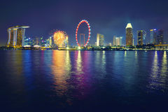 Singapore city skyline at night. Singapore city skyline shining at night with fireworks Royalty Free Stock Photos