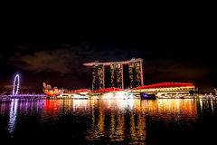 Singapore city skyline at night and view of Marina Bay Top Views. Singapore city at night with laser show Royalty Free Stock Photos