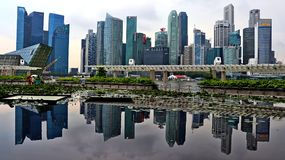 Singapore city skyline with self reflection royalty free stock image