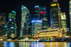 Singapore city skyline view of business district in the night ti. Me, with beautiful water reflections Stock Image
