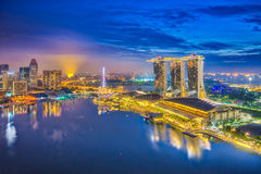 Singapore city skyline and view of Marina Bay at night in Singap. Ore city Royalty Free Stock Photos