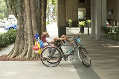 Poor man in Singapore. Singapore is city state where one can hardly see homeless people thanks to to public housing system. Public housing in Singapore is stock image