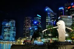Singapore Cityscape. Cityscape of Singapore business district with Merlion statue at night Royalty Free Stock Image