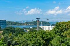 Singapore cityscape with funicular to Sentosa island over the ba Stock Photos