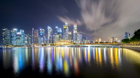 Singapore cityscape with urban buildings. Singapore - November 27, 2017: Beautiful Singapore cityscape with urban buildings and colorful light at night Royalty Free Stock Photo