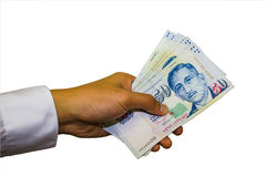 Singapore Currency with Hand Isolated in white background Royalty Free Stock Photos