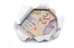 Singapore currency peeking through white paper Royalty Free Stock Photo