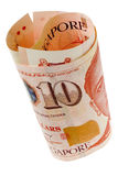 Singapore currency rolled. Rolled Singapore dollar notes isolated on white background Stock Image