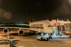 Singapore - Dec 21, 2017 - Singapore Airlines Airbus A380 at loading bay Stock Images