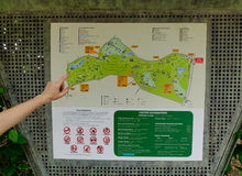 A hand on map of city park in Singapore. Singapore - Dec 14, 2015. A hand on the map of city park in Singapore. Singapore, referred to as the Lion City, the royalty free stock photography