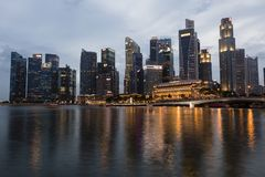 SINGAPORE, December 9, 2017: Skyline of financial district in Singapore. At dusk Stock Photography