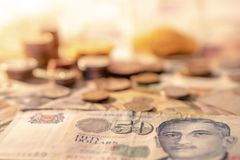 Singapore dollar banknote and coins stack Stock Photography
