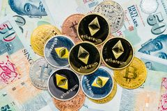 Singapore Dollar banknotes and Bitcoin Cryptocurrency and Ethere Stock Images