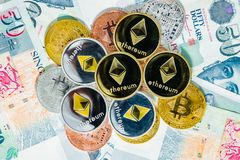 Singapore Dollar banknotes and Bitcoin Cryptocurrency and Ethere Royalty Free Stock Photo