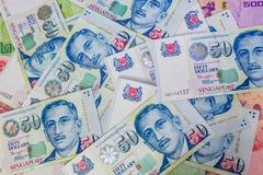 Singapore dollar, sedel Singapore och thailändsk baht i hörnet Royaltyfria Bilder