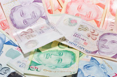 Singapore Dollars. A pile of singapore fifty, ten, five and two dollars Stock Photography