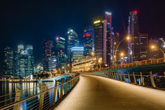 Singapore downtown night view. Panoramic night view of Singapore bussines district from bridge Royalty Free Stock Images