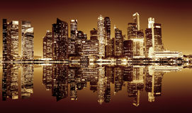 Singapore downtown night view. Panoramic night view of Singapore bussines district in sepia colors Royalty Free Stock Photos