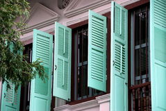 Singapore: Emerald Hill Peranakan House. Mint green louvered shutters on a beautifully restored Peranakan Chinese house on historic Emerald Hill off Orchard Road Stock Image