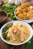 Singapore famous curry noodle or laksa mee with decorations on b. Ackground photo Stock Photo