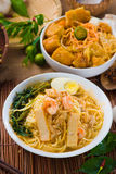 Singapore famous prawn noodle or har mee with decorations on background stock images